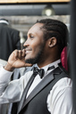Smiling elegant man talking on phone in tailor shop - LFEF00122