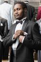 Portrait of a man wearing tuxedo in tailor shop - LFEF00125