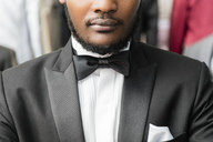 Close-up of a man wearing tuxedo in tailor shop - LFEF00128