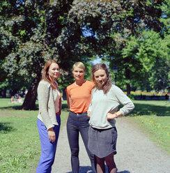 Three women standing in park - FOLF00822