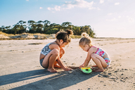 Sisters playing at beach - CAVF28709