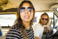 Young couple sitting in mini van - CAVF28802