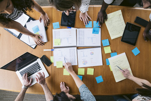 High angle view of business people planning in board room - CAVF29048