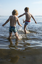 Two boys walking in water - FOLF01457