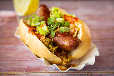 Asian hot dog, fried sausage, spicy chinese cabbage, hot chili sauce, spring onions, cress, bun - KSWF01890