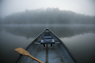 Boat in lake during foggy weather - CAVF29728