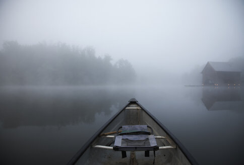 Boat in lake against sky during foggy weather - CAVF29731