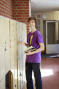 Teenage boy opening locker - FOLF02129