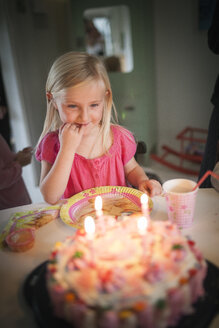Girl looking at birthday cake - FOLF02162