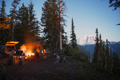 Camp fire on cliff by trees at North Cascades National Park - CAVF30058