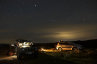 Off-road vehicle and SUV at Gifford Pinchot National Forest during night - CAVF30163