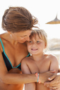 Mother embracing her daughter on beach - FOLF02306