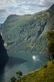 Ship sailing by mountains in Geirangerfjord - FOLF02420