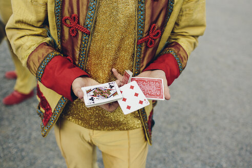 Young circus performer holding cards - FOLF02492
