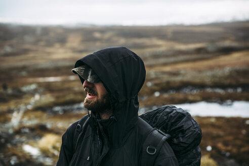 Portrait of backpacker in hooded jacket - FOLF02516