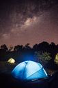 Illuminated tent on field at night - CAVF30628
