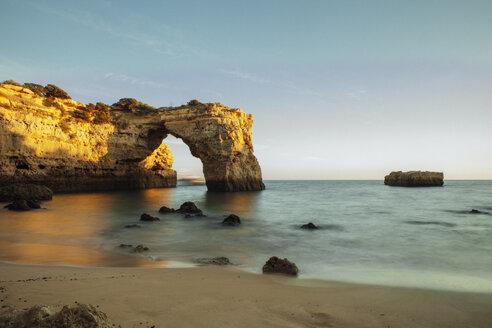 Scenic view of natural arch in sea at Algarve against clear sky - CAVF30661