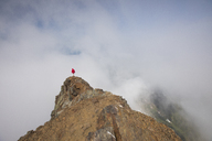 High angle view of man standing on Cheam Peak against cloudy sky - CAVF30915
