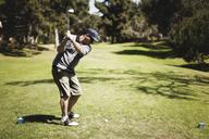 Golfer playing on field at golf club - CAVF31014