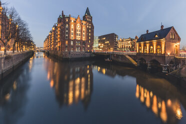 Germany, Hamburg, Speicherstadt, lighted building Fleetschloesschen in the evening - KEBF00776