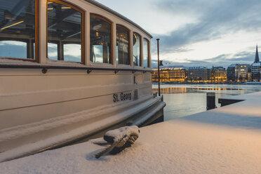 Germany, Hamburg, Inner Alster Lake and tourboat in winter - KEBF00782