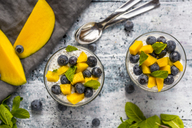 Two glasses of chia pudding with mango and blueberry - SARF03632