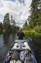 Man paddling canoe along river - FOLF03885