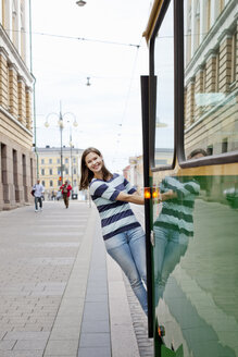 Young woman leaning out of tram - FOLF03936