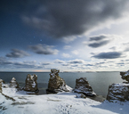 Rock formations in snow at coastline - FOLF04071