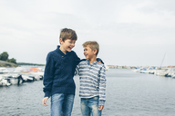 Boys standing next to marina and laughing - FOLF04284
