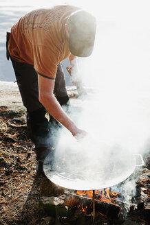 Man standing by fire - FOLF04335