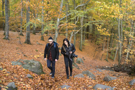Man and woman walking in forest during autumn - FOLF04491