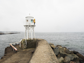 Man standing on lighthouse by sea - FOLF04494