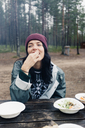 Woman eating outdoors - FOLF04779