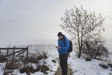Man walking on a snowy trail - FOLF04791