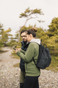 Hiking couple on smart phone - FOLF04860