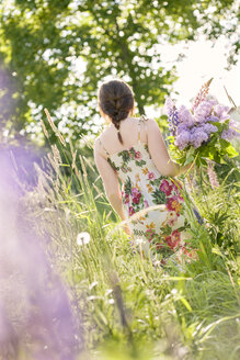 Young woman in field of common lilacs - FOLF05007