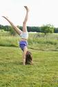 Girl doing cartwheel - FOLF05016