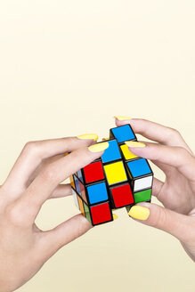 Close-up of woman's hand with Rubik's Cube - SRY00784