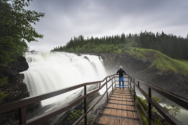 Man at lookout of waterfall in Jamtland, Sweden - FOLF05187
