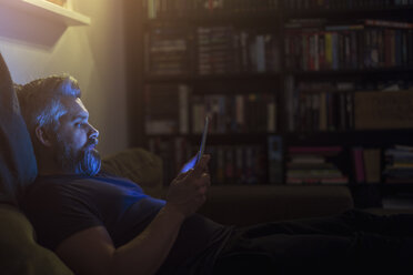 Man on sofa with tablet PC - FOLF05202