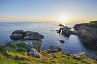 United Kingdom, England, Cornwall, Land's End, Natural Arche and Armed Knight at sunset - RUEF01849