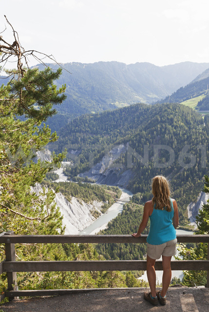 Switzerland, Grisons, woman looking to Rhine river and Ruinaulta - GWF05478