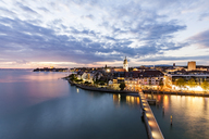 Germany, Baden-Wuerttemberg, Friedrichshafen, Lake Constance, city view and jetty in the evening - WDF04522