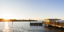 Germany, Baden-Wuerttemberg, Langenargen, Lake Constance, shipping pier at sunrise - WDF04525
