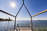 Germany, Baden-Wuerttemberg, Lake Constance, Lake Ueberlingen, Unteruhldingen, observation deck against the sun - WDF04531