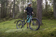 Mature man with bicycle in forest - FOLF05525