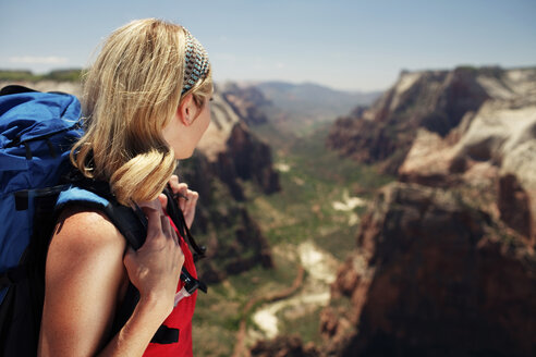 Side view of woman looking at view from mountain - CAVF31184
