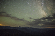 Scenic view of silhouette mountains against star field at night - CAVF31295