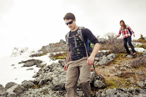 Low angle view of friends hiking on mountain - CAVF31313